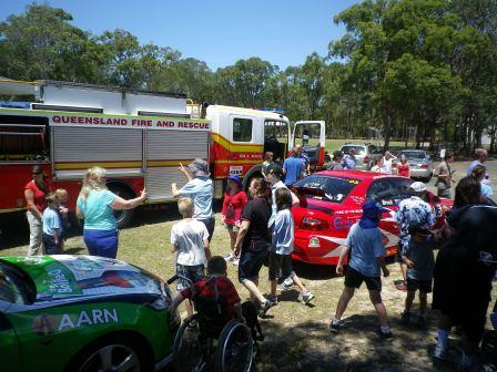Emergency vehicles and cars visit school